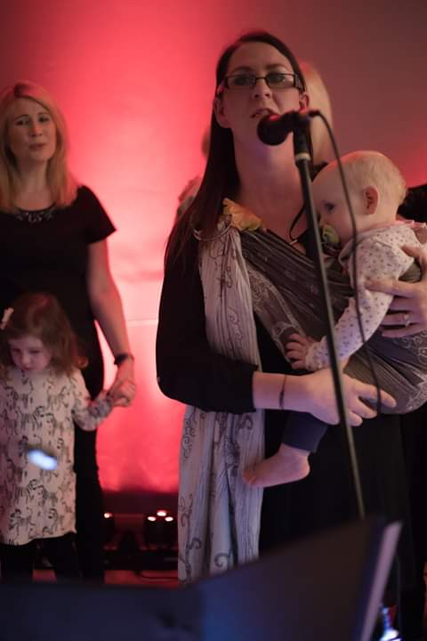 Ailish singing in the Mammies Choir with her child